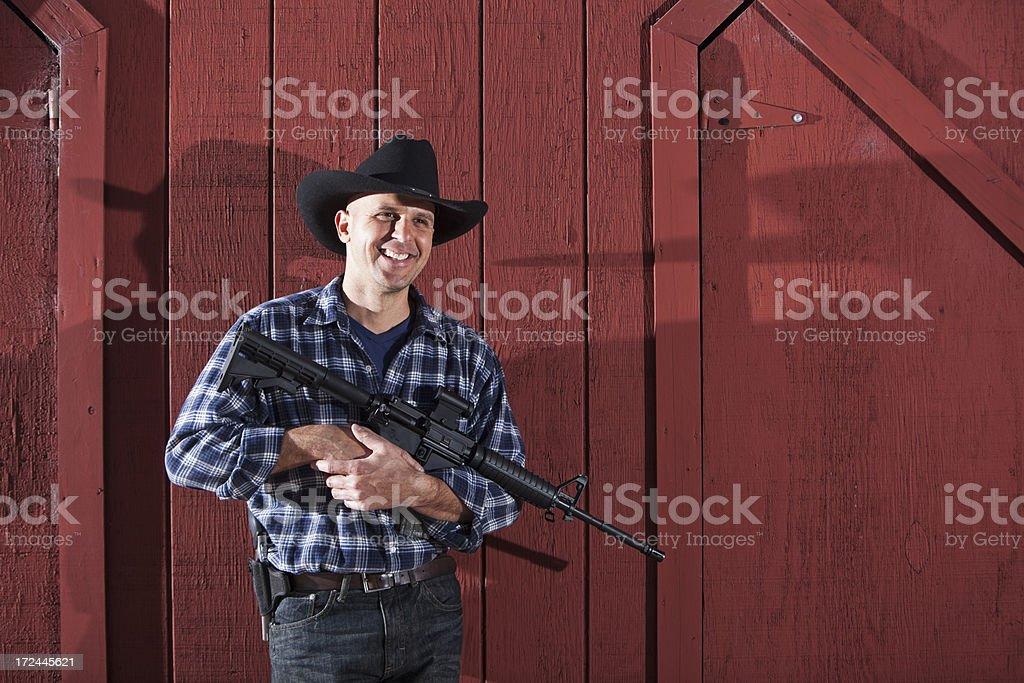 Man holding rifle royalty-free stock photo
