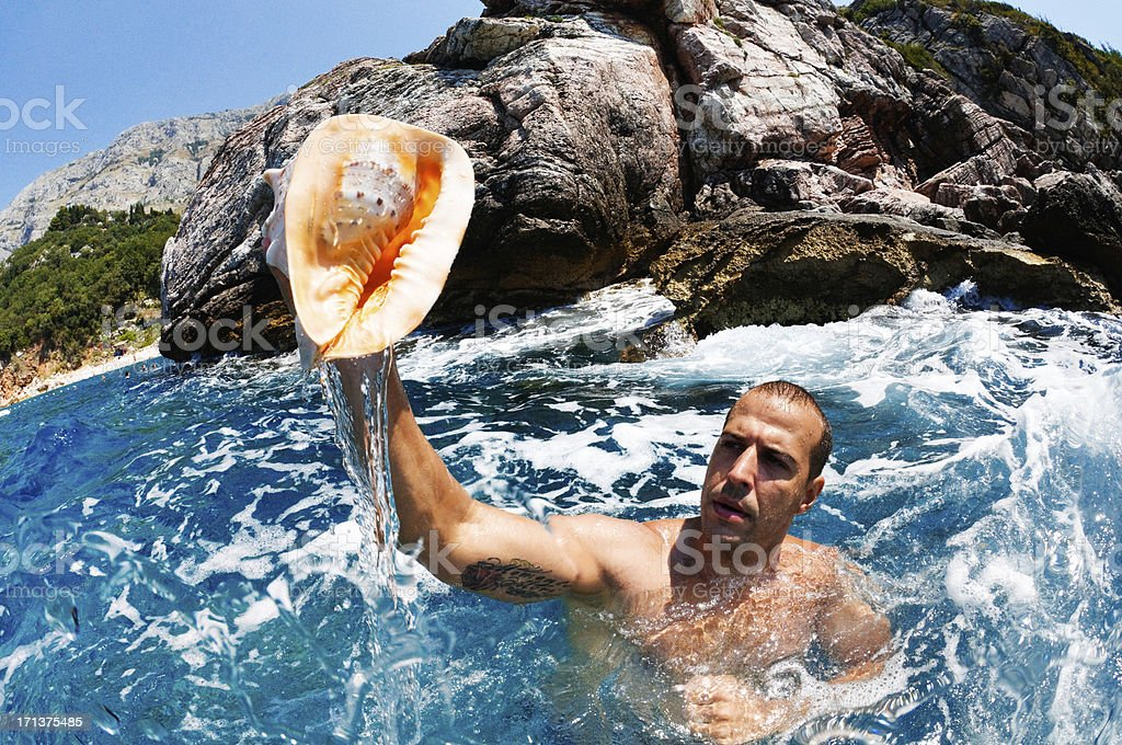 Man Holding Seashell stock photo