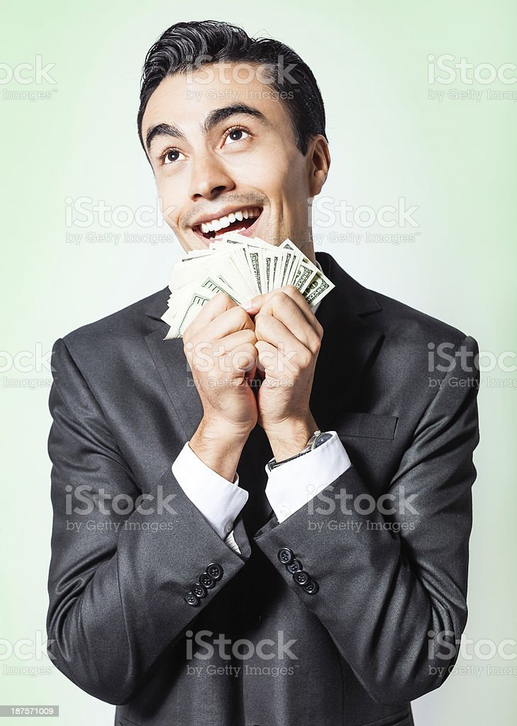 A man holding several bills while smiling royalty-free stock photo