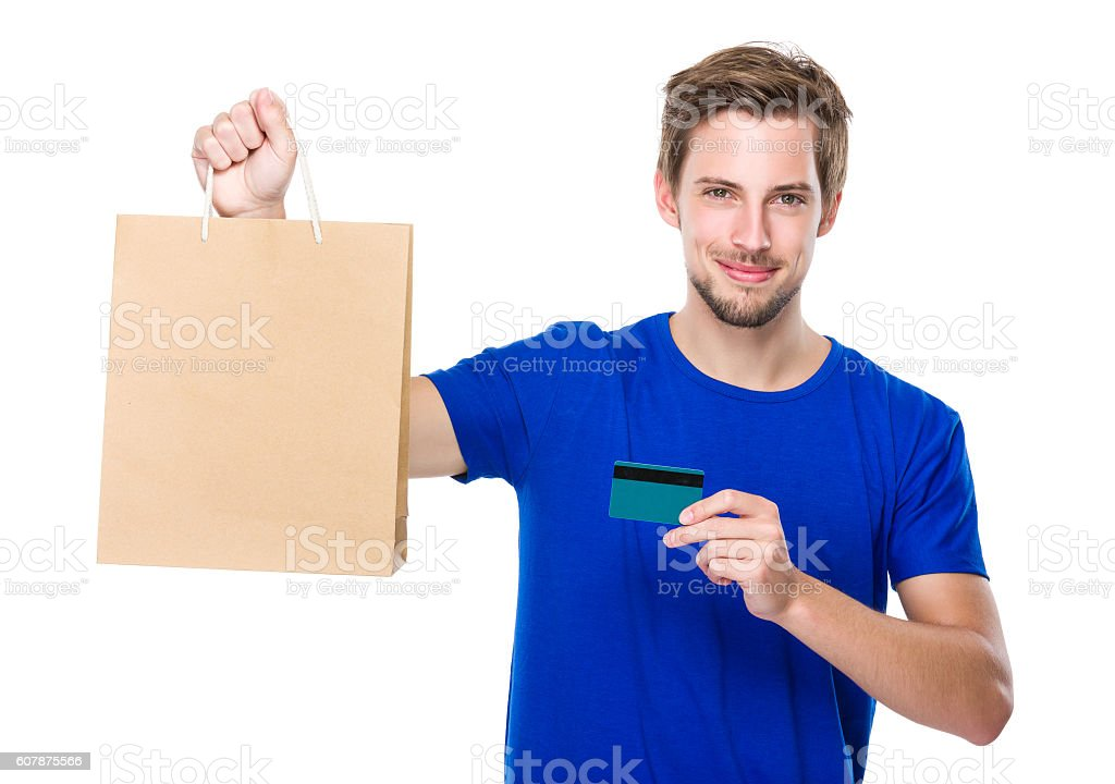 Man holding shopping bag and credit card stock photo