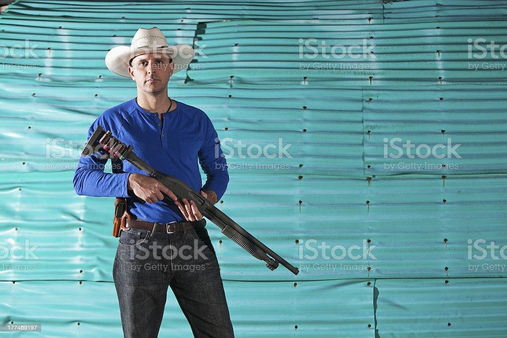 Man holding shotgun royalty-free stock photo