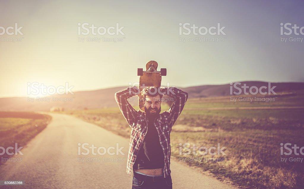 Man holding skateboard stock photo