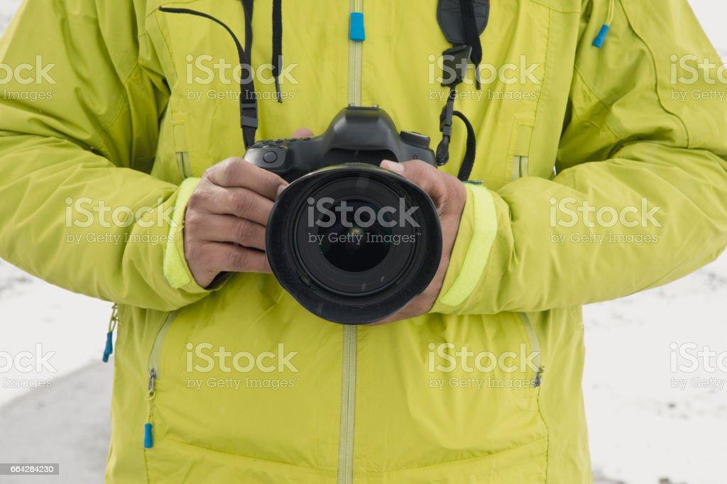 Man holding SLR camera stock photo