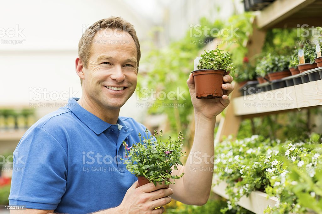 Man Holding Small Potted Plants royalty-free stock photo
