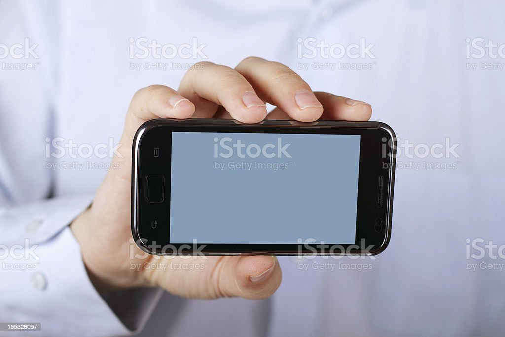 man holding smart phone royalty-free stock photo