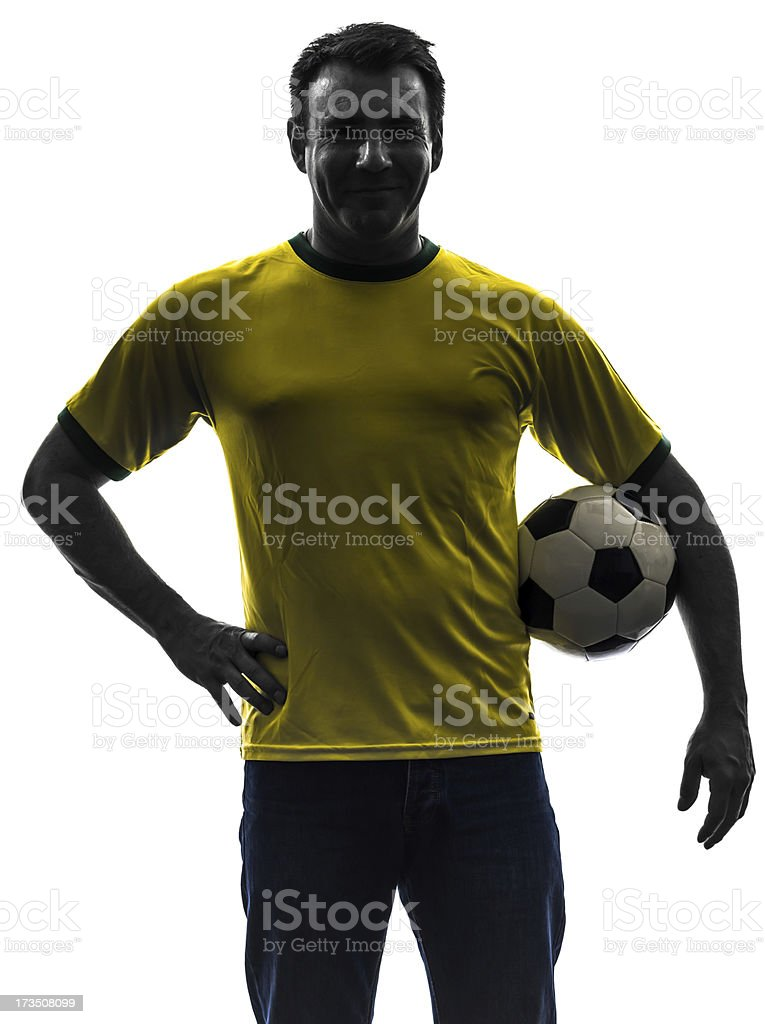 man holding soccer football silhouette stock photo
