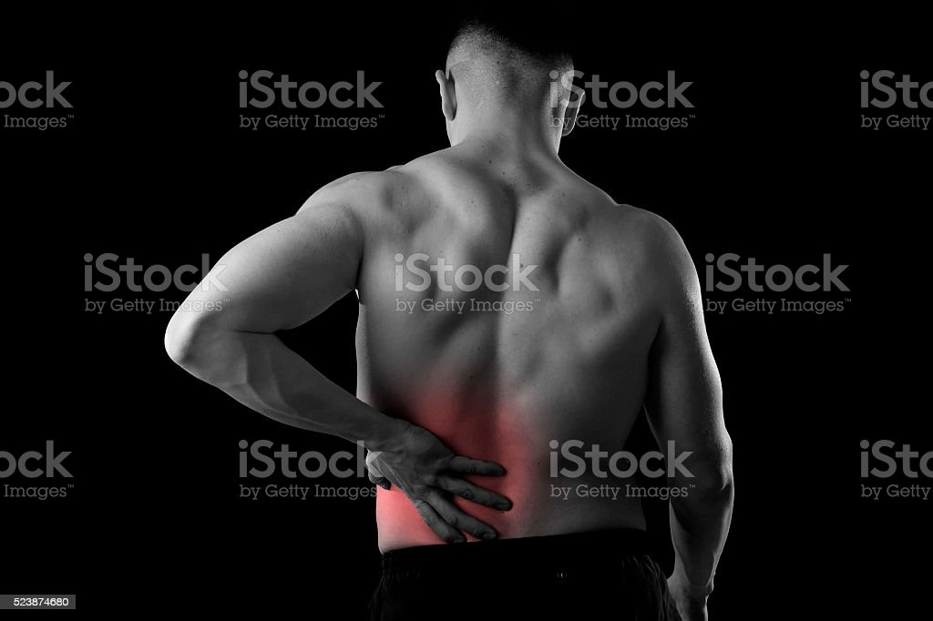 man holding sore low back waist  suffering body pain stock photo