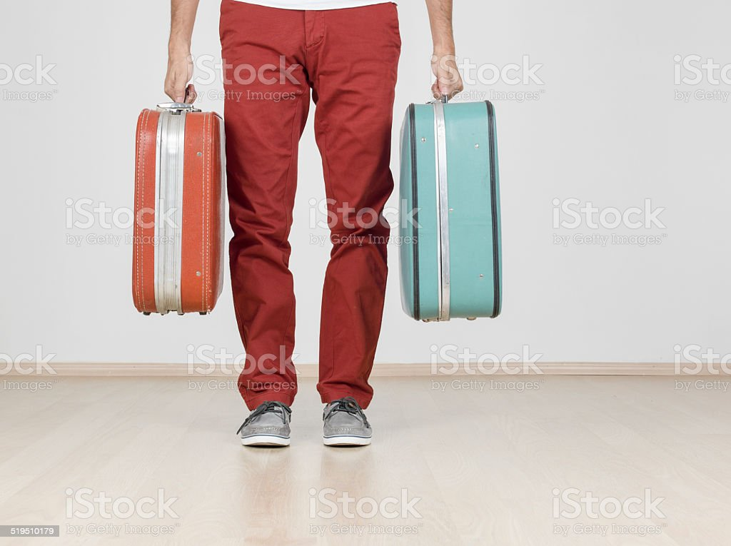Man holding suitcases, indoors stock photo