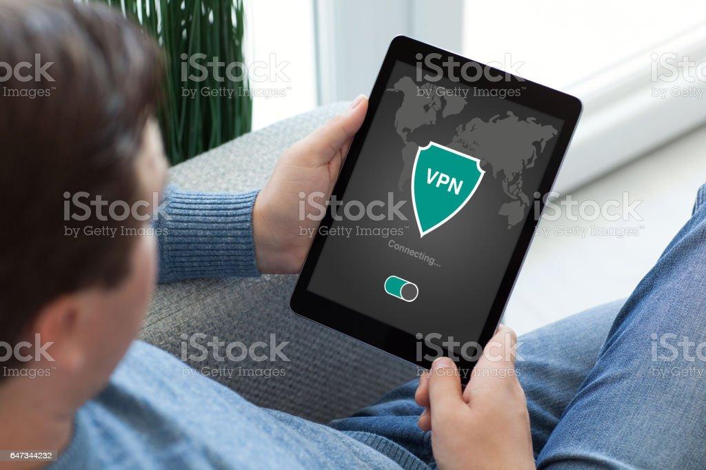 man holding tablet app vpn creation Internet protocols protection network stock photo