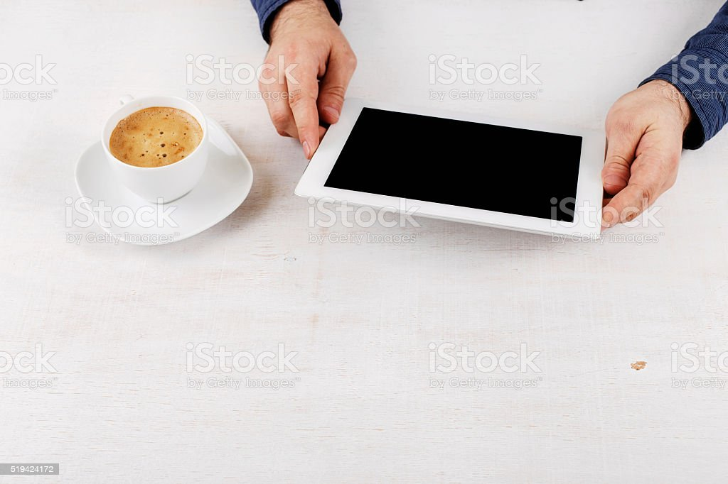 Man holding tablet stock photo