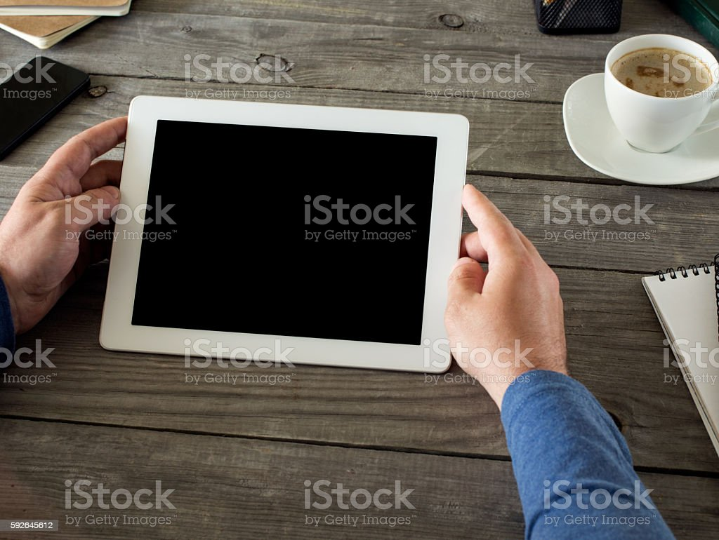 Man holding tablet with blank screen stock photo