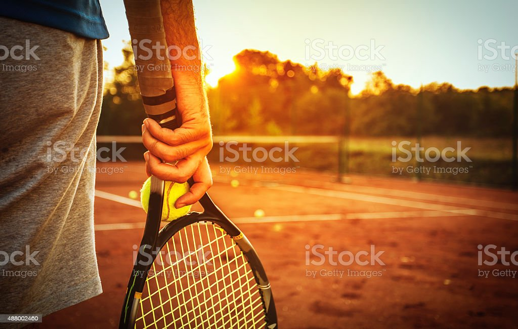 Man holding tennis racket stock photo