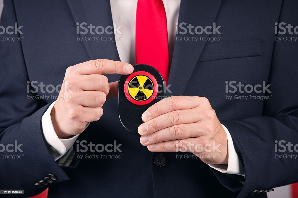 Man Holding The Button stock photo