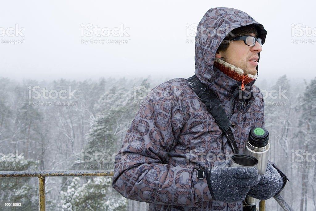 Man holding thermos. stock photo