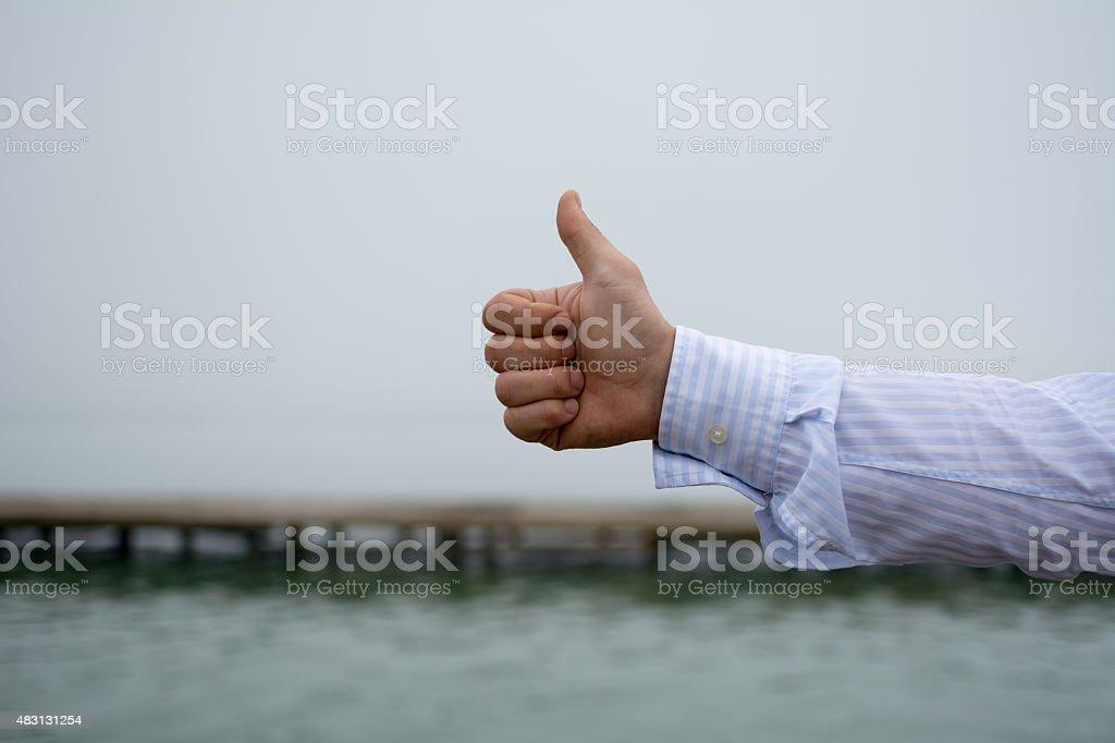 Man holding thumb up stock photo