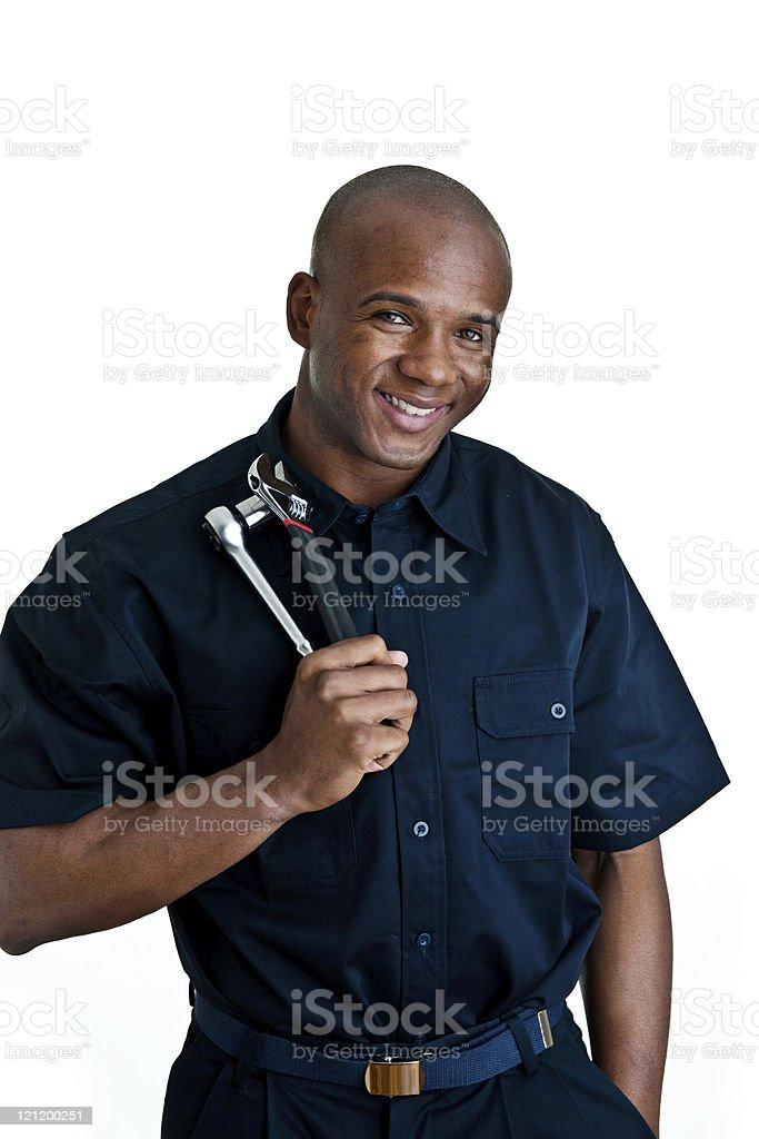 Man holding tools wearing mechanic clothing stock photo