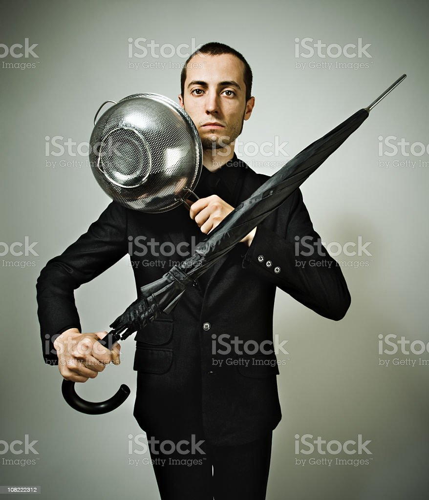 Man Holding Umbrella and Coliander royalty-free stock photo