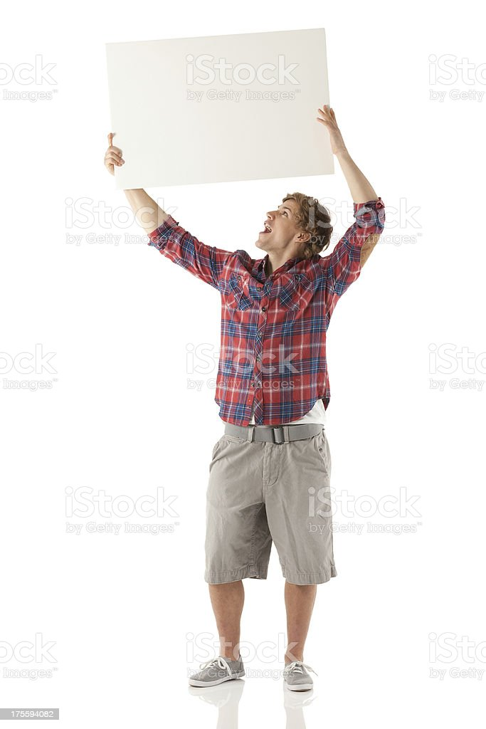 Man holding up a placard stock photo