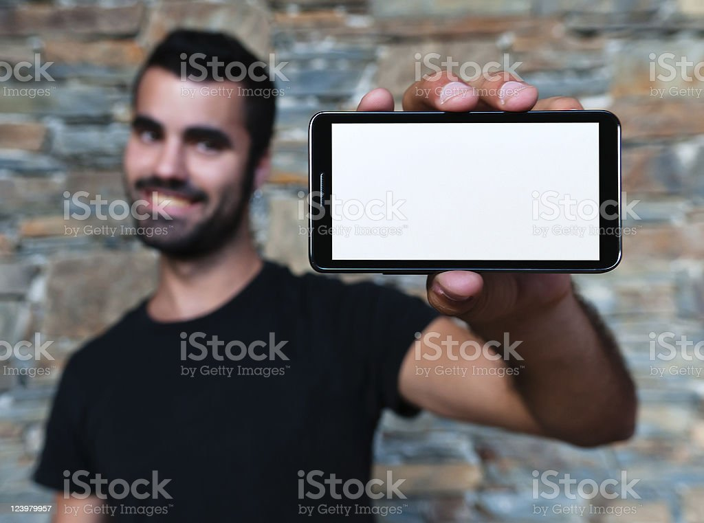 Man holding up his blank mobile phone royalty-free stock photo