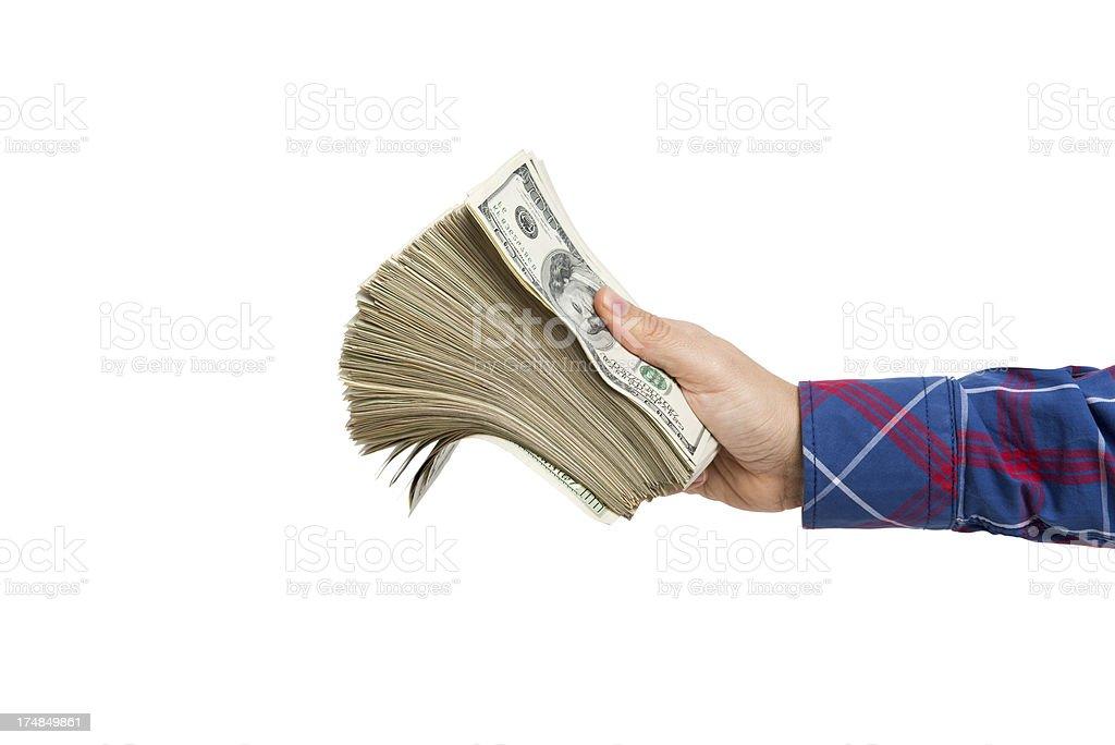 Man holding wad of US dollar banknotes royalty-free stock photo