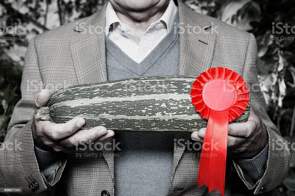 Man holding winning marrow stock photo