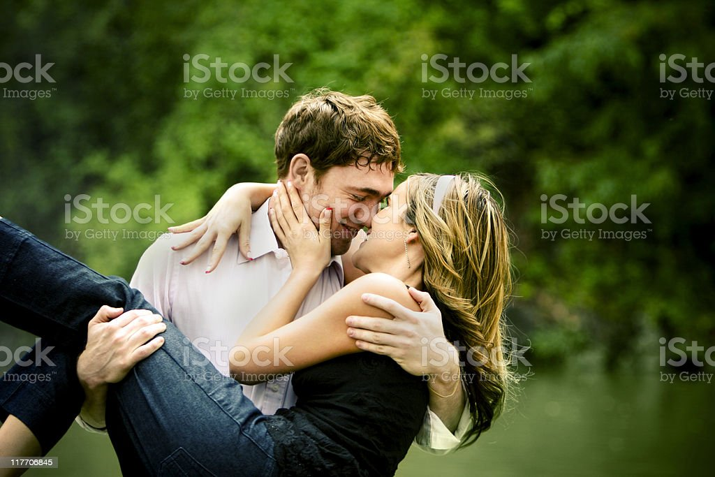 Man holding woman romantically in arms royalty-free stock photo