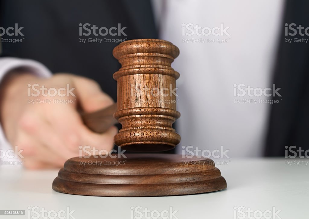 Man holding wooden gavel stock photo