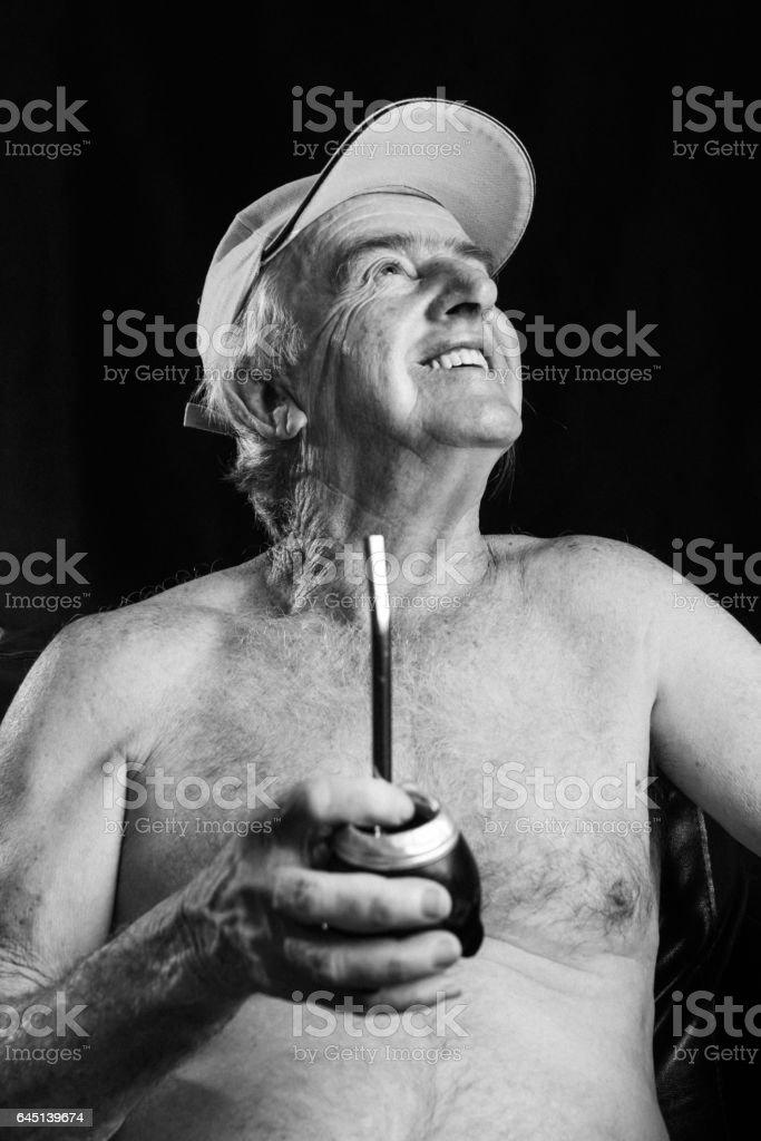 Man holding Yerba Mate, Chimarrão drinking stock photo
