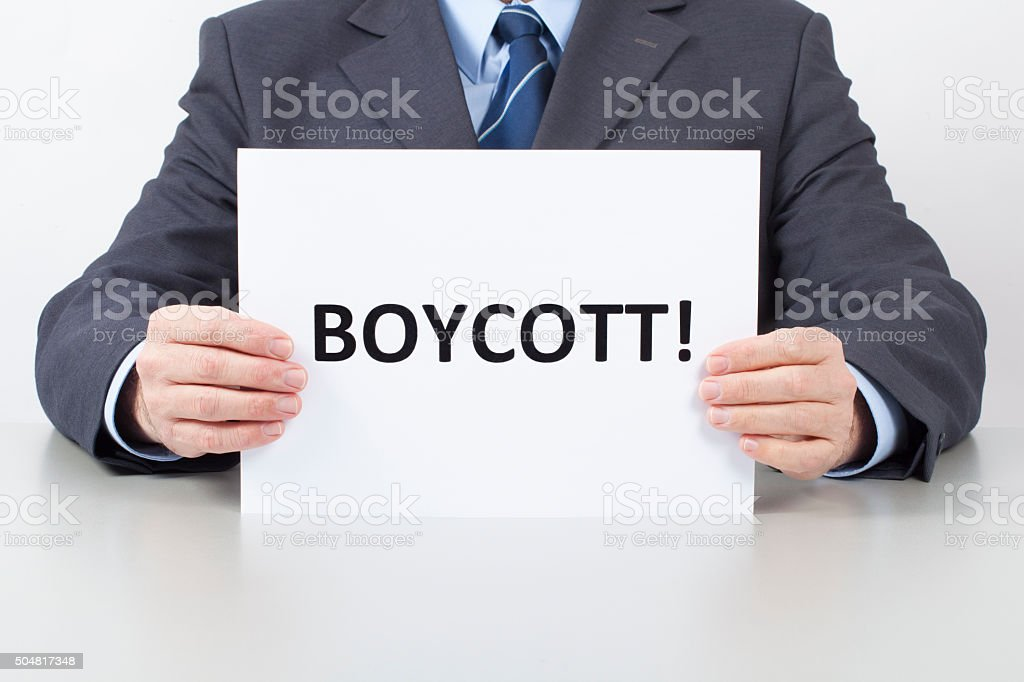 Man Holds a Sheet with a Text Boycott stock photo