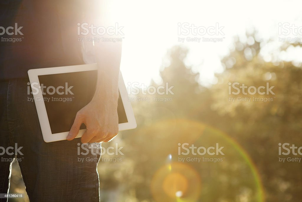 Man holds digital tablet royalty-free stock photo