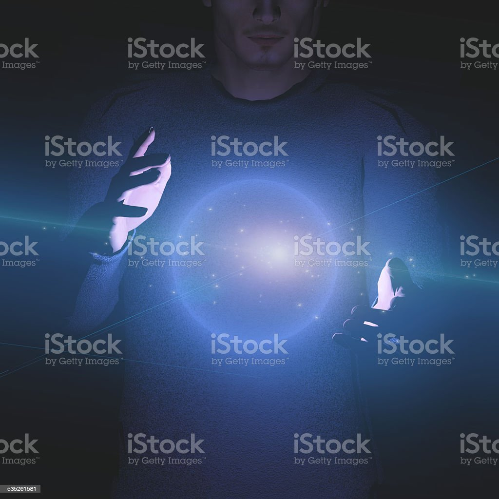 Man holds energy between his hands stock photo