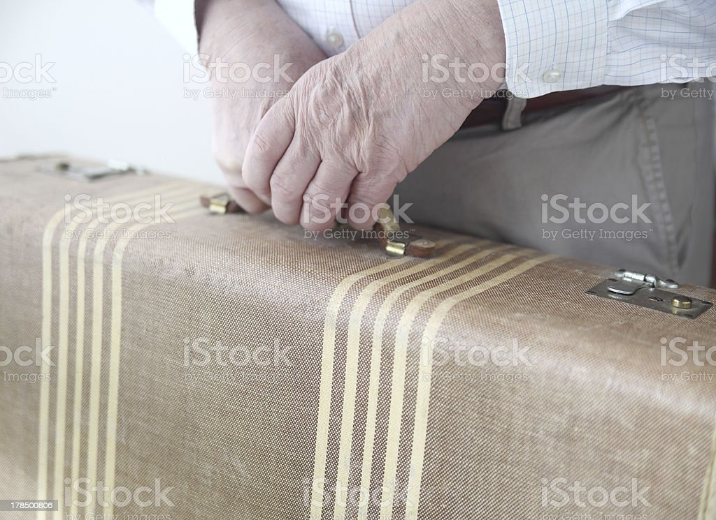 man holds old suitcase royalty-free stock photo