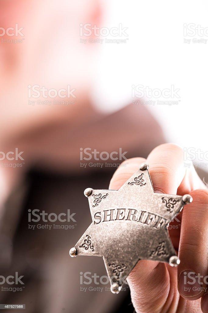 Man holds sheriff badge stock photo