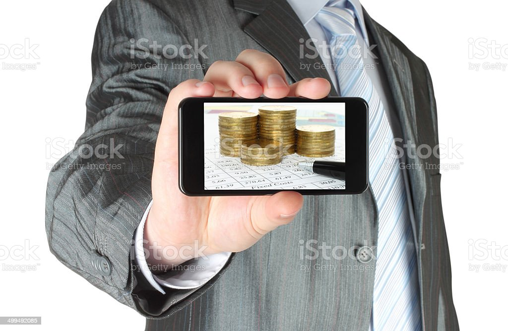 Man holds smart phone with business composition stock photo