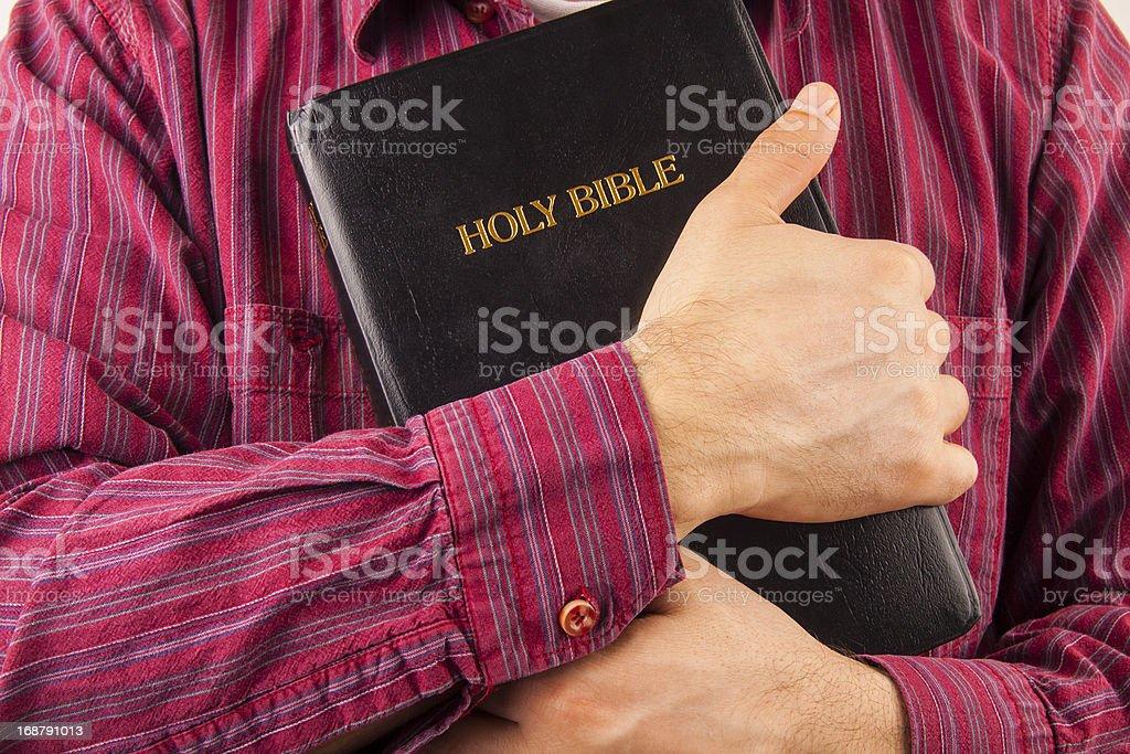 Man hugging a Bible royalty-free stock photo