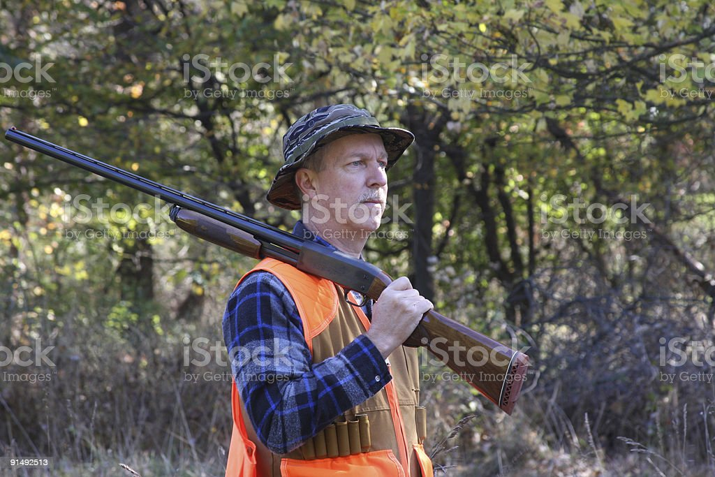 Man Hunting in a Field royalty-free stock photo