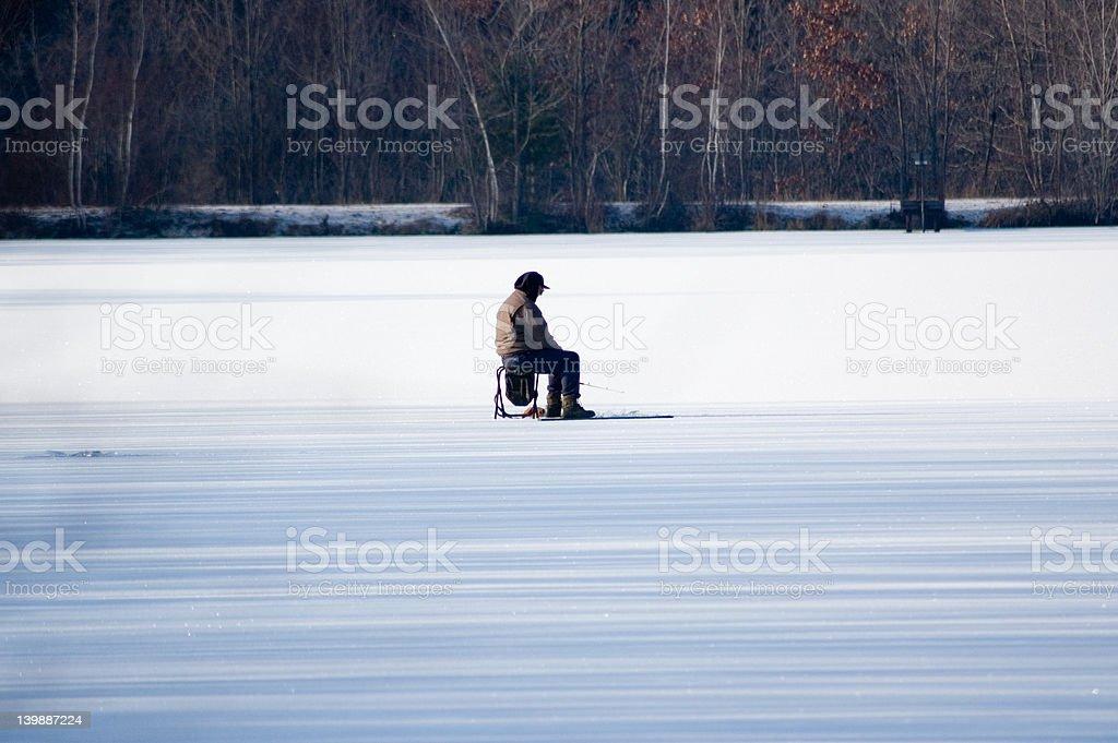 man ice fishing stock photo