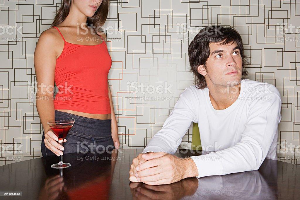 Man ignoring approaching woman stock photo