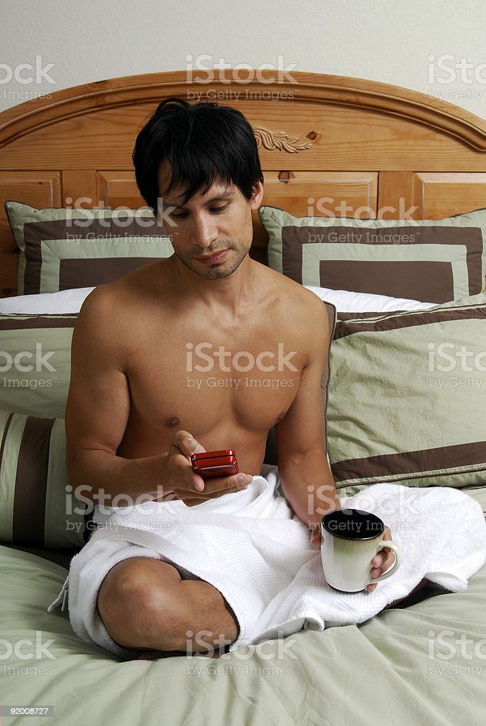 Man in a bed royalty-free stock photo