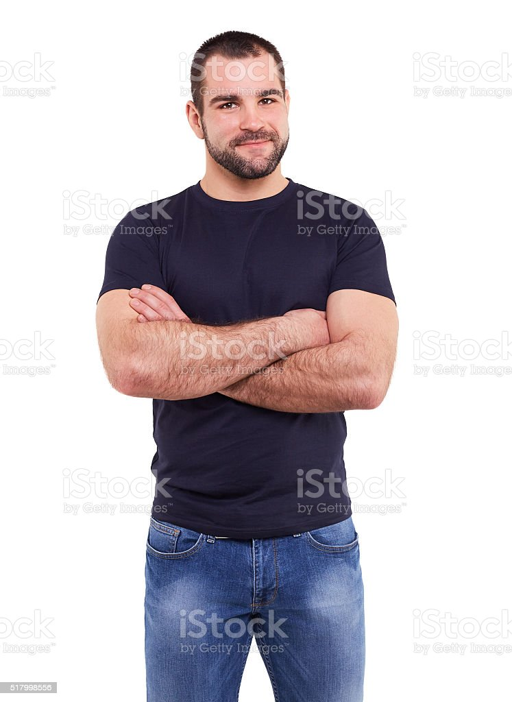 Man in a black shirt with crossed arms stock photo