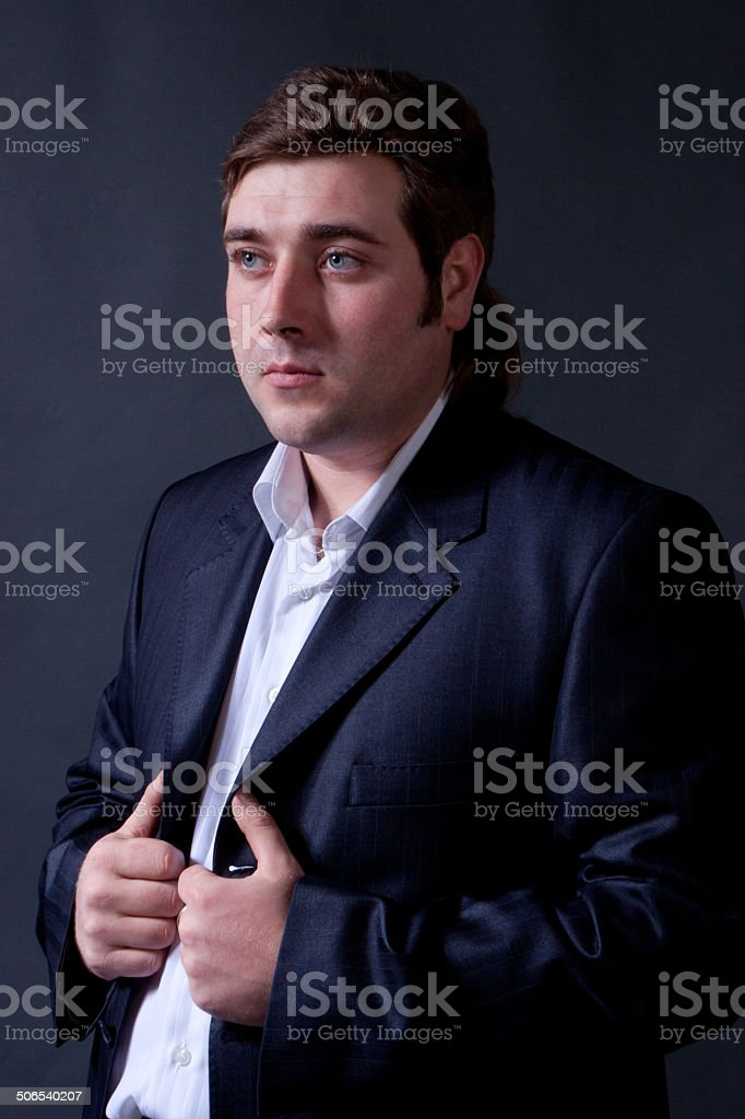 man in a black suit stock photo