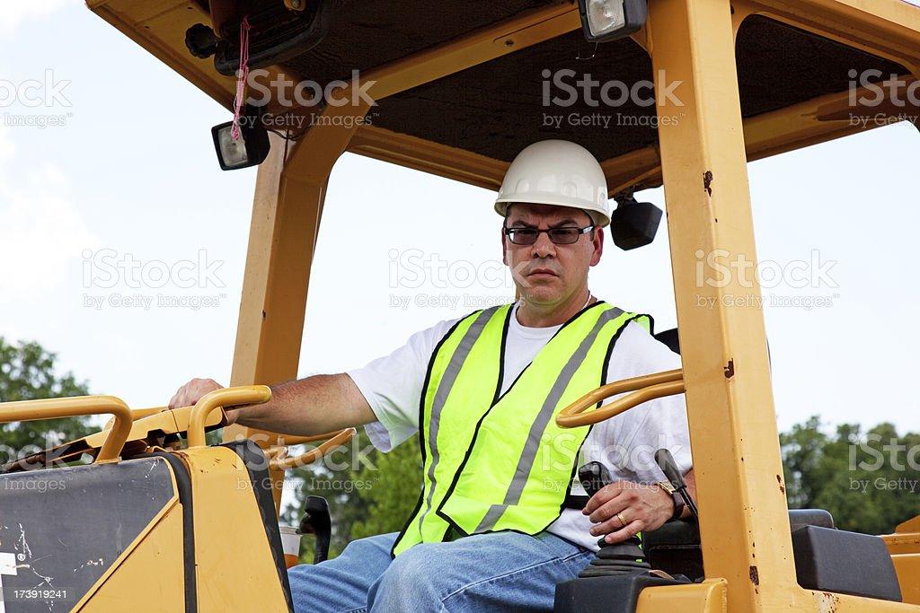 Man in a Buldozer royalty-free stock photo