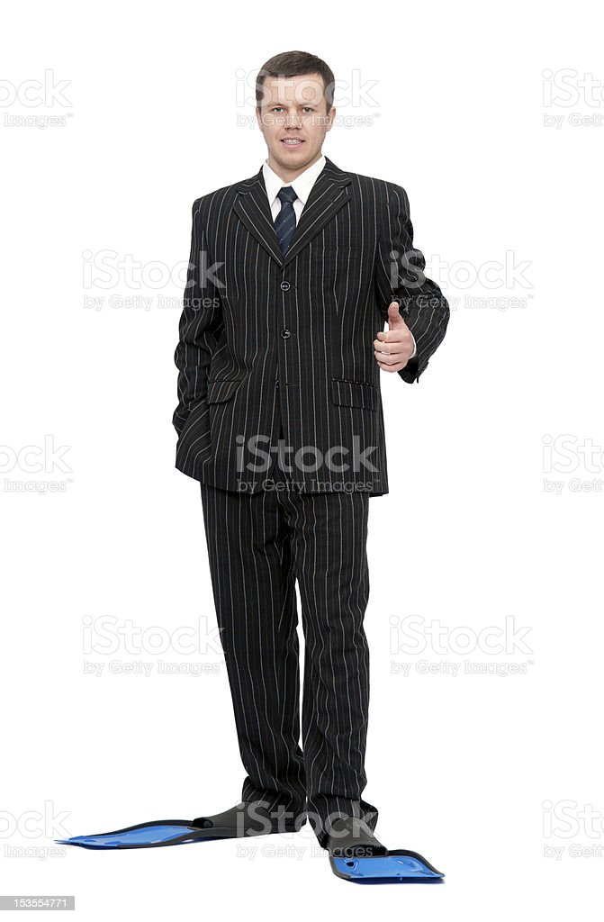 man in a business suit and flippers for swimming stock photo