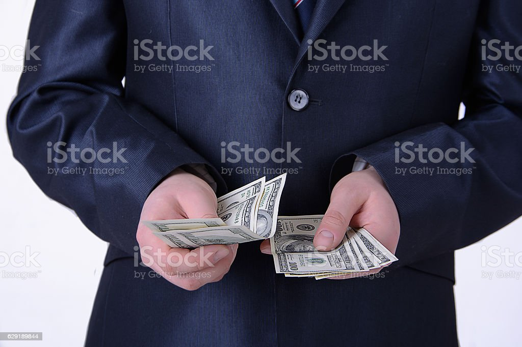 man in a business suit offers money stock photo