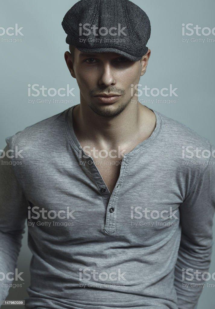 Man in a cap stock photo