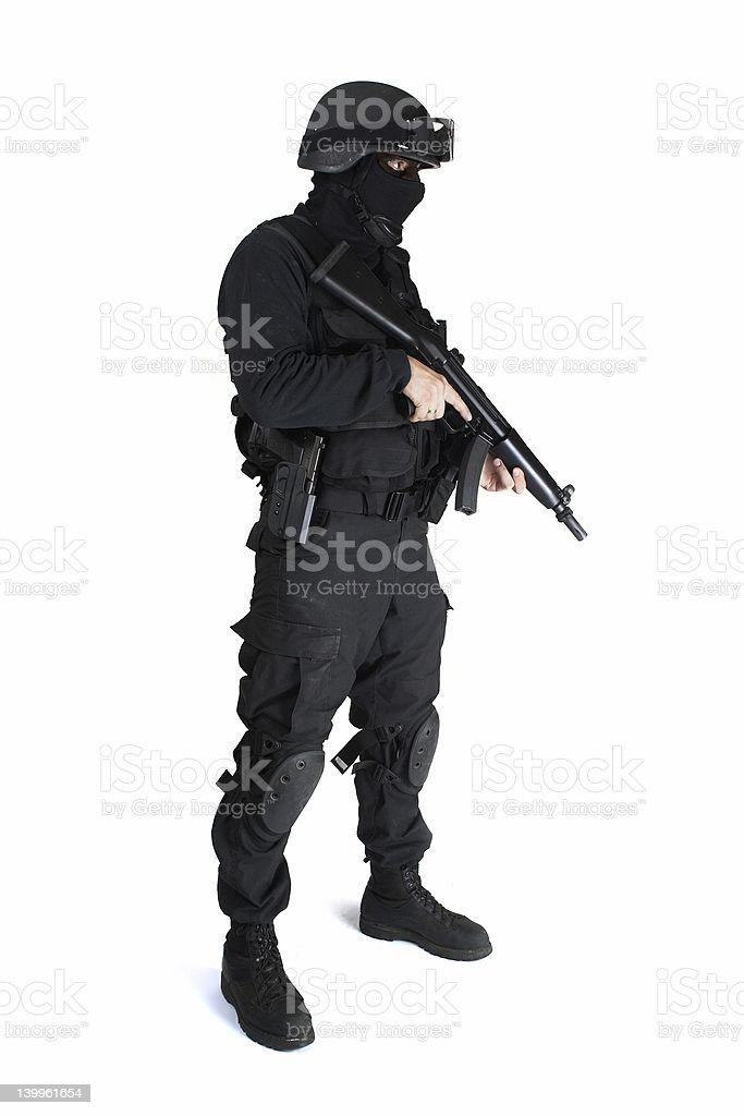 A man in a commando outfit with a weapon stock photo