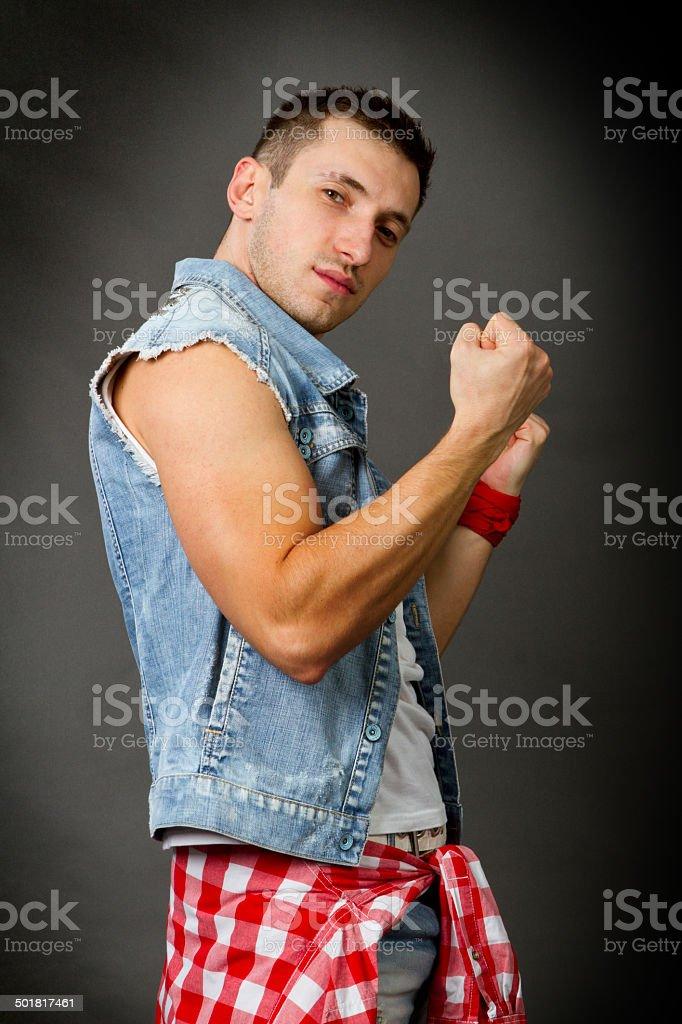 man in a denim vest stock photo