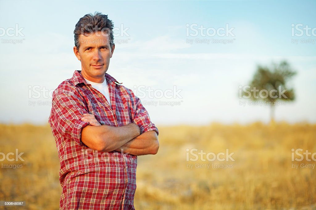 Man in a field stock photo