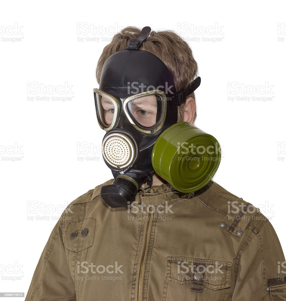 Man in a gas mask on a light background stock photo