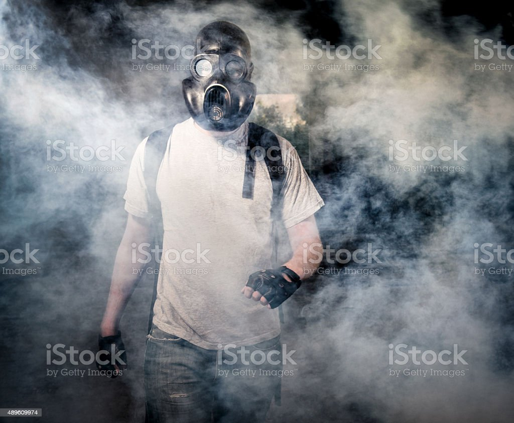 Man in a gas mask stock photo